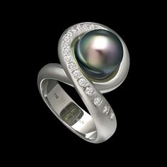 Aria Tahitian Pearl Ring by Adam Neeley. Aria is memorable and harmonious. This ring features a dazzling Tahitian pearl with diamonds in 14 karat white gold. Conch Jewelry, Pearl Jewelry, Jewelry Art, Jewelry Rings, Jewelry Design, Pearl Rings, Designer Jewelry, Women's Rings, Fine Jewelry