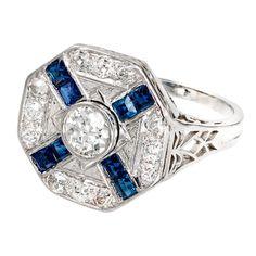 "Art Deco Sapphire Diamond Platinum Ring. Original Art Deco 1920 octagonal ring with bright blue Sapphires set in an ""X"" with an original old European cut diamond center. EGL certified. Totally original. All handmade. c 1920"