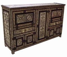 An exotic and one of a kind african carved cabinet, made of cedar, all hand carved in Morocco.
