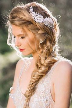Make sure you look and feel flawless on your wedding day with a beautiful hairstyle like this fishtail braid!