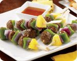 Asian flavors of soy, saki, ginger and a hint of sweetness in the Teriyaki sauce blend excellent with the meatballs and tart pineapple.     Grilling these kabobcreates a light sweet glaze.