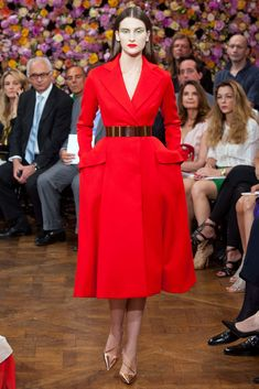 Fall 2012 Haute Couture - No one else could masterfully use color quite like he did. Here, a lipstick-red coat-dress combined his sensibilities with the Bar hourglass silhouette iconic to the brand.