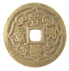 """Old Chinese charm with four characters written in seal script。The legend is read top to bottom and right to left as ji qing ru yi (吉庆如意).  The first character is ji (吉) which means """"lucky"""", """"happy"""" or """"auspicious"""".  The second character is qing (庆) which means """"good luck"""" or """"congratulate"""".  The last two characters are ruyi (如意) which means """"according to your wishes"""".  The entire inscription can be roughly translated in English to mean """"may your happiness be according to your wishes""""."""