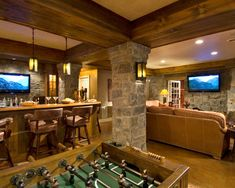 Finished Basement: Mixed elements of wood, leather, stone - box beam ceiling, stone column, great use of space (get three areas out of one - pub/gameroom/tv area)