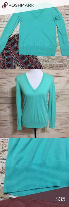 """J.Crew Soft Stretchy Sweater Soft and cozy sweater by J.Crew in a beautiful aqua color. The perfect way to add a pop of color into your fall and winter wardrobe! Hits below hips. Is extremely stretchy and in excellent condition. 100% cotton. Perfect with jeans or easy to dress up on top of a button down and slacks. Bust 18"""" across unstretched from armhole to armhole. Length 24.5"""". J. Crew Sweaters V-Necks"""