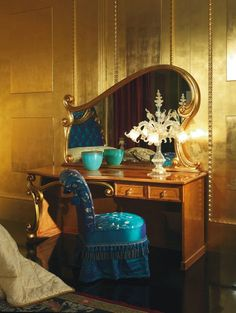 Art Nouveau peacock blue fringed satin vanity chair with matching table.  I'm not sure it's possible to have more of my favorite things in one place!