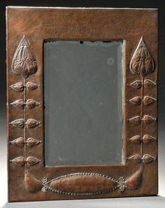 English Arts & Crafts mirror,  repoussé copper over wood, early 20th century, ht. 17 1/2, wd. 14 3/8 in.