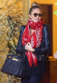 56b0bdf1668 Chrissy Teigen hides her baby bump behind stylish red scarf
