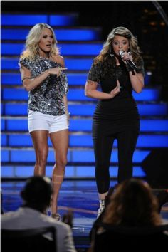 I like the Carrie Underwood's outfit on the left