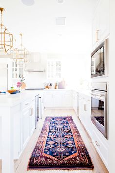 Beautiful white kitchen with vintage rug