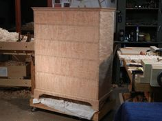 Curly Cherry Chest of drawers ready for finish made by Doucette and Wolfe Furniture Makers