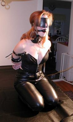 Redhead in latex harness