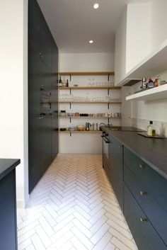 View the full picture gallery of Marcadet Appartement Small Galley Kitchens, Home Kitchens, Lava, Kitchen Breakfast Nooks, Kitchen Dinning Room, Oak Shelves, Kitchen Worktop, Stone Countertops, Home Remodeling