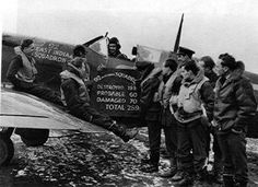 """Pilots of No 92 Squadron RAF pose in front of Spitfire Mk Ia QJ-P at RAF Manston on 6 February 1941, with the squadron scoreboard amended to record their 130th enemy aircraft destroyed. Sitting on the wing (third from left) is Sgt Ralph E """"Tich"""" Havercroft, the unit's shortest airmen at 5ft 2in. There were several aircraft requiring repair following night landing accidents, including the one depicted that crashed at RAF Pembrey on 31 August, when Havercroft became disorientated by ground…"""