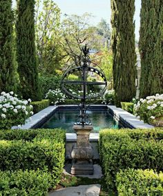 cypress-shaded swimming pool at hotelier Jeff Klein and film producer John Goldwyn's Hollywood Hills home.The cypress-shaded swimming pool at hotelier Jeff Klein and film producer John Goldwyn's Hollywood Hills home. Formal Gardens, Outdoor Gardens, Modern Gardens, Jardin Decor, Hollywood Hills Homes, Design Jardin, Water Features In The Garden, Garden Features, White Gardens