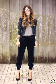Fall / Winter Outfit Idea: Navy blue velvet drawstring joggers worn with a chic blazer and mirrored sunglasses