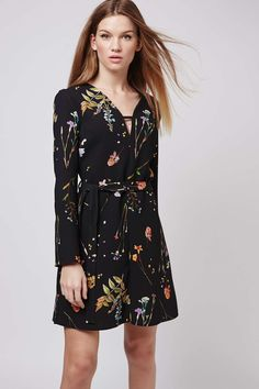 Pretty florals and whimsy prints are a must-have this season. Embrace the trend with this spin on the classic tunic dress. The tie waist and floaty sleeves create a fluid silhouette that is finished with a T-bar neckline for on-trend style. 100% Polyester. Machine wash.
