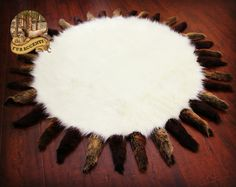 WHAT A BEAUTIFUL AREA RUG! CLASSIC ROUND WHITE BEAR FUR WITH SOFT BROWN TAIL FRINGE! DESIGNED AND MADE IN THE USA BY FURACCENTS.COM  AND ITS ALL FAUX! TOO RICH FOR WORDS.