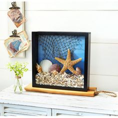 Showcase your beach house memories inside a lovely, nautical shadow box.