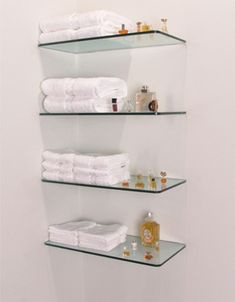 One of the few things I want to finish off my master bath.  Free floating glass shelves <3