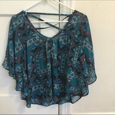 Geometric sheer top sheer with an open, criss-cross back *best worn with a bandeau *I always got compliments when I wore this, but it's not my style   *100% polyester *I offer discounts for bundles, make me an offer :) jcpenney Tops Blouses