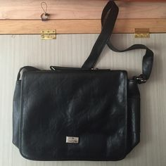NWOT Black Leather Messenger Bag Never used before. Only flaw is in the last picture (the weird bubbles). Not Urban Outfitters. If you have any questions feel free to ask me and check out my closet! ✨ Urban Outfitters Bags