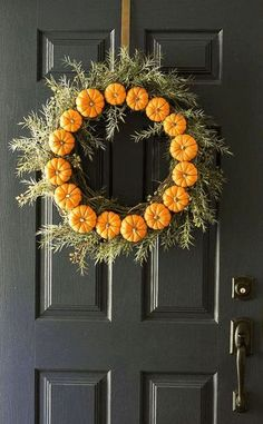 If you don't want your stoop littered with pumpkins, this is a totally easy, just as festive option. To make a mini pumpkin wreath, just wire each pumpkin to a garland (wrapping the wire around the stem to secure) and add a hanger made of wire to the back. Bam!