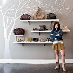Make a feature of personal accessories in the home with shelving. The wall art brings it all together.