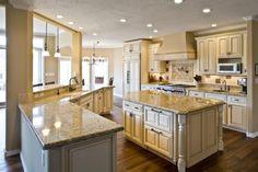 Cream kitchen cabinets, wood floor