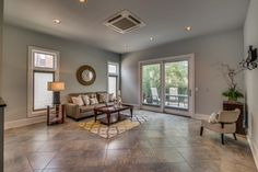 The beautiful slate flooring, recessed lighting, and french doors to a private patio make this a perfect space!