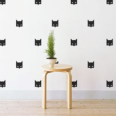 Inspire your imagination with the superhero styling of the removable Mini Batman Mask Wall Decal from Little Sticker Boy.