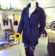 Add some style to your rainy day outfit with our drawstring waist hoodie jacket (available in navy and black) and cozy print leggings. Accessorize with a sunflower for good luck! 🌻☔️ #ootd #boutique #style #fashion #fall #rain #jacket #stormyday #sunflower #leggings #womenfashion #shopping #retailtherapy #mosaicdistrict #bedifferent #standout #shopsmall #supportlocal
