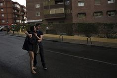 Credit: Susana Vera/Reuters Amaya Munoz, 31, is consoled by her friend Alberto after she is evicted from a rented flat in Madrid. Munoz says she was made redundant a year ago and could not afford to keep paying her rent.