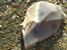 Portable Rock Art and Figure Stones - Eoliths: Biface flint scraper.