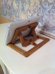 Beautiful and useful iPad/ Tablet stand. Handmade from gorgeous oak wood. The stand fit to iPad, iPad 2, iPad 3, iPad 4, Tablet and devices with similar sizes. Size approximately: Length: 20 cm Width: 20 cm Height: 15 cm Fashionable and stylish stand for the tablet of wood style loft, three positions.