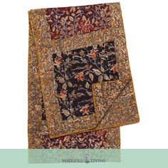 A blend of beautiful earthy tones, the reversible Zoya patchwork table runner uses Kalamkari block printing techniques from South India. Colorful printed square patches in 2 designs alternate to form a modern geometric pattern, separated and edged with borders in a third print. Just flip it on the reverse to enjoy a single print Kalamkari design.