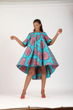 The large flair midi high and low dress made with green and wine ankara fabric. Description: The PBA maxi-flounce midi dress. Color Pattern as seen on model & Available in different colour mix Kindly send email for additional colors. African Fashion Ankara, Latest African Fashion Dresses, African Print Fashion, Short African Dresses, African Print Dresses, Ankara Dress, Ankara Gown Styles, Ankara Fabric, African Attire