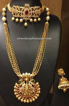A beautiful south  indian jewellery featured here is one of the best gold long chain designs in 50 grams.simple antique long chain with small gold beads chain in multiple layers with antique vinayaka gold pendant paired with choker and jhumkas. For long chain designs in gold with weight and price contact Bhavani Jewellers Phone: 9908194122 what's app …