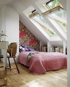 love the slanted skylight like windows, the one printed wall, the bookshelves....