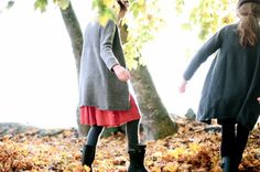 red skirt. gray tights. black boots. gray cardigan. (these girls dress so beautifully.) [ source: first sight daily ]