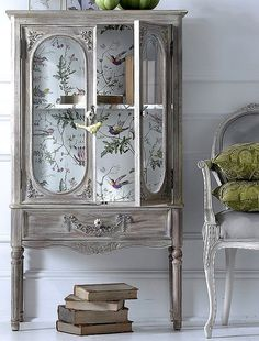 Going to do this in my hallway cabinet.....We can us wall paper in the alcoves to bring a element of interest