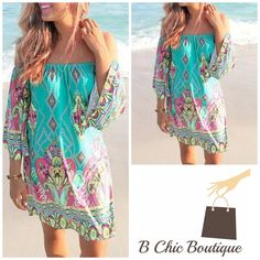 """Off Shoulder Boho style dress Beautiful mix of aqua, fuchsia , pink, yellow and blue in a boho print. Off shoulder but can be worn on the shoulder. Made of soft lightweight cotton/poly blend. 3/4 sleeves with a semi pleated A line cut. Fuchsia   Measurements  Small Bust 39""""/ waist 33""""/ length 28.3""""  Medium  Bust 41""""/ waist 34.5""""/ length 28.7""""  Large  Bust 43""""/ waist 36.5""""/ length 29.2"""" Bchic Dresses Long Sleeve"""