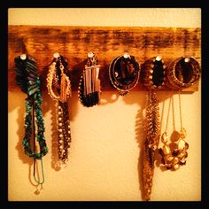LOVE this simple jewelry hanger! Barn wood + flat nails = rustic elegance <3