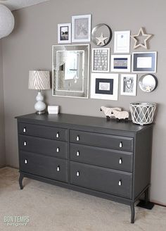 Love the picture frames above the dresser