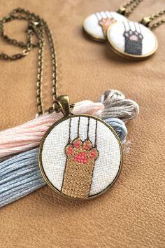 Artículos similares a Cat paw pendant/ Cross stiched jewellery en Etsy Tiny Cross Stitch, Cat Cross Stitches, Cross Stitching, Cross Stitch Embroidery, Embroidery Patterns, Cross Stitch Patterns, Beaded Cross, Crochet Cross, Goth Dress