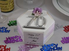 White silk hexagonal favour box with lilac tea rose for 70th birthday