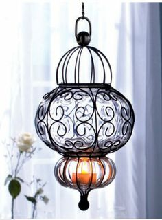 Bohemian Handblown Glass with LED tealights Hanging Pendant in Clear LDI,http://www.amazon.com/dp/B00HOU4GK4/ref=cm_sw_r_pi_dp_nCevtb0ZHEJ0HEPJ