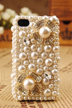 My other new cell phone case...I swap out between this one and the bow one:) You can never have enough pearls<3