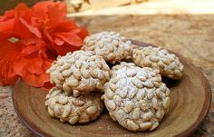 "Pignoli Cookies ~ A delicious Italian Cookie ~ ""A perfect addition to any holiday cookie tray, these delicious traditional cookies will be a hit with family and friends alike. To make this cookie, almond flavored dough is rolled in pine nuts, which is then baked until golden brown."""