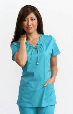 This popular solid top features adjustable front ties, side slits and two deep front patch pockets. Cute Scrubs Uniform, Scrubs Outfit, Stylish Scrubs, Koi Scrubs, Womens Scrubs, Medical Scrubs, Scrub Tops, Blouse Styles, Maternity Dresses